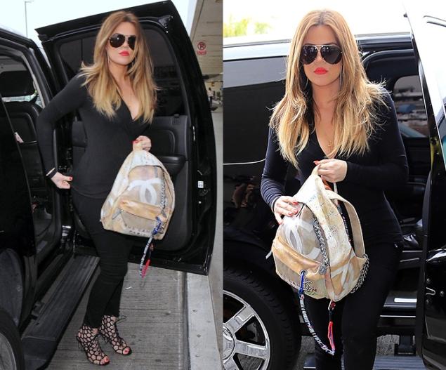 Khloe Kardashian heads into LAX to catch a flight
